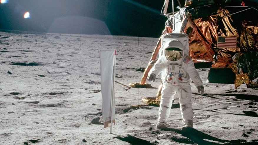 Buzz Aldrin stands on lunar surface in front Lunar Landing Module during Apollo 11's lunar mission.