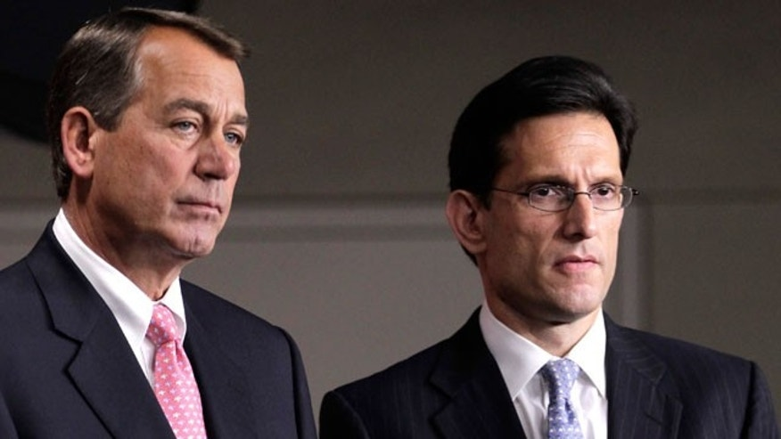 In this file photo of Thursday, June 16, 2011, House Majority Leader Eric Cantor of Virginia, right, stands with House Speaker John Boehner of Ohio on Capitol Hill in Washington. (AP)