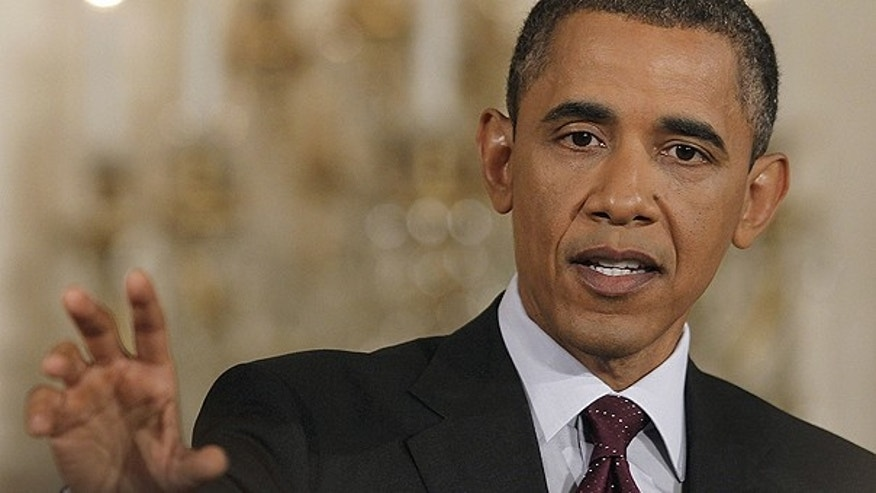 June 29: President Obama gestures during a news conference in the East Room of the White House in Washington.