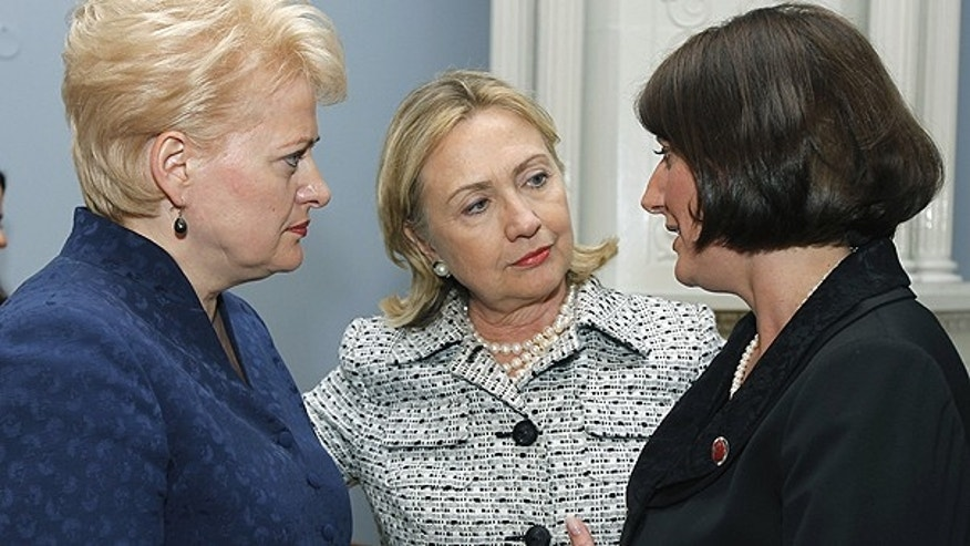 June 30: From left, Lithuania's President Dalia Grybauskaite, Secretary of State Hillary Clinton , and Kosovo President Atifete Jahjaga, speak at the Presidential Palace in Vilnius, Lithuania.
