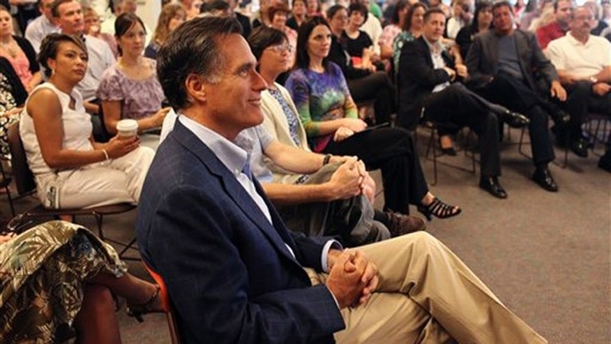 Former Massachusetts Gov. Mitt Romney waits while he is introduced to employees at Lincoln Financial Group in Concord, N.H., June 27.