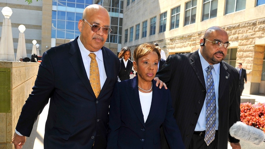 In this June 30, 2011 photo, Rev. Jonathan L. Weaver, left, walks with Prince Georges County Council member Leslie Johnson outside the U.S. District Court in Greenbelt, Md.