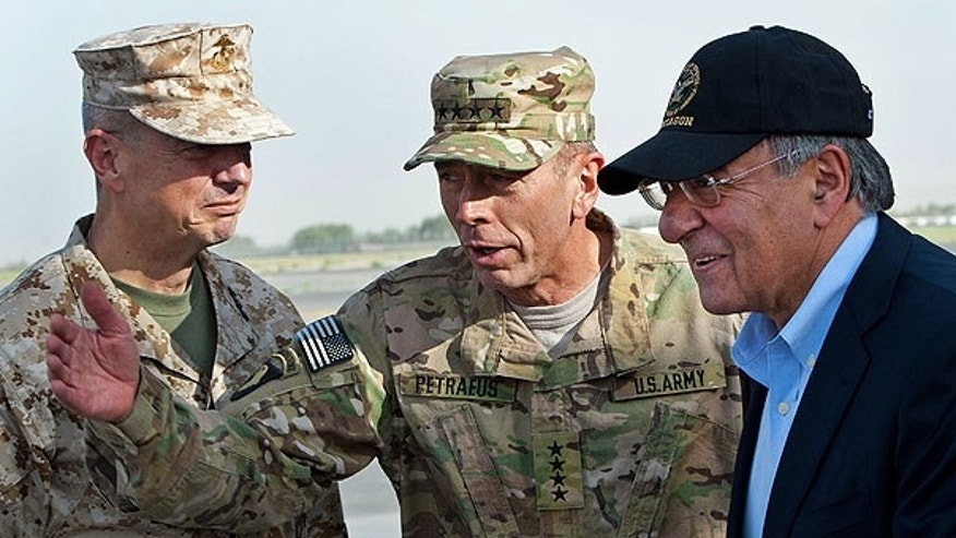 July 9: USMC Gen. John Allen, left, and Army Gen. David Petraeus, top U.S. commander in Afghanistan and incoming CIA Director, greet former CIA Director and new U.S. Defense Secretary Leon Panetta, right, as he lands in Kabul, Afghanistan.
