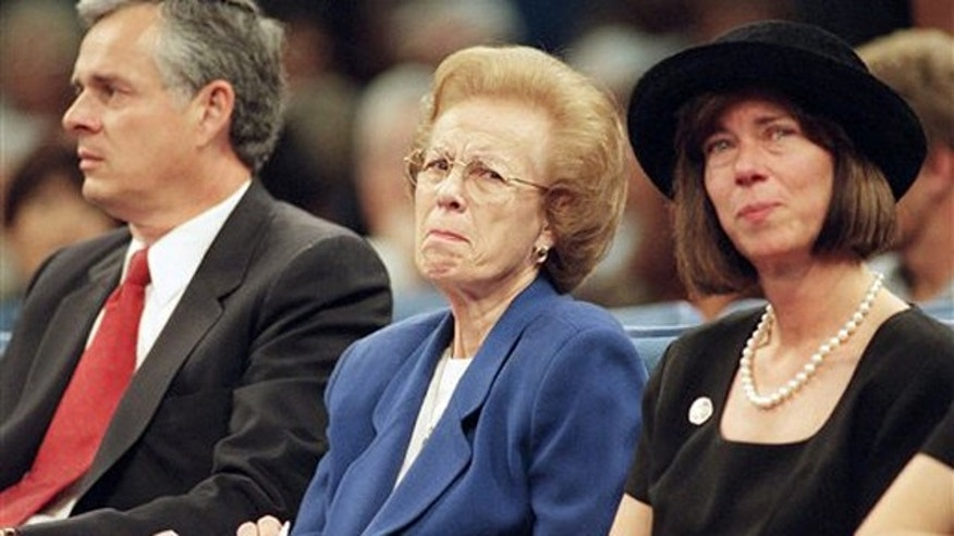 In this Oct. 17,1997 file photo Ramona Hahn, wife of the late supervisor Kenneth Hahn flanked by her son Jim, left and daughter, Janice, during a memorial service for her husband at the Crenshaw Christian Center in Los Angeles.  Ramona Hahn, the matriarch of a Los Angeles political family, has died at 86. Hahn was the wife of the late Los Angeles County Supervisor Kenneth Hahn, and the mother of former Mayor James Hahn and City Councilwoman Janice Hahn.
