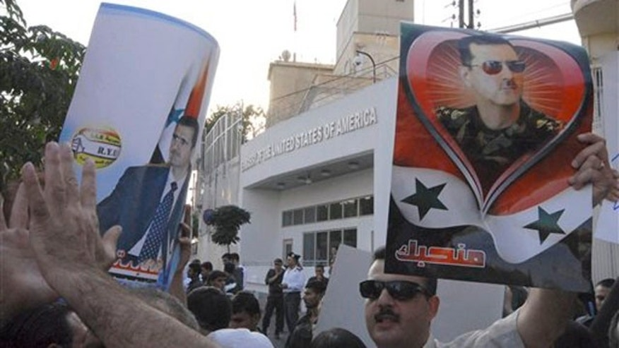 Friday: Pro-Syrian President Bashar Assad protesters gather in front the U.S. Embassy in Damascus.