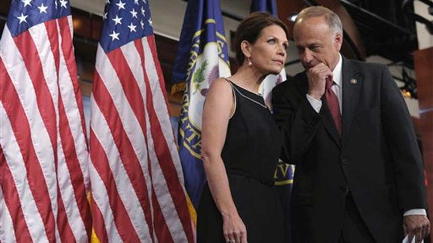 Wednesday: Rep. Michele Bachmann speaks with Rep. Steve King during a news conference on Capitol Hill.
