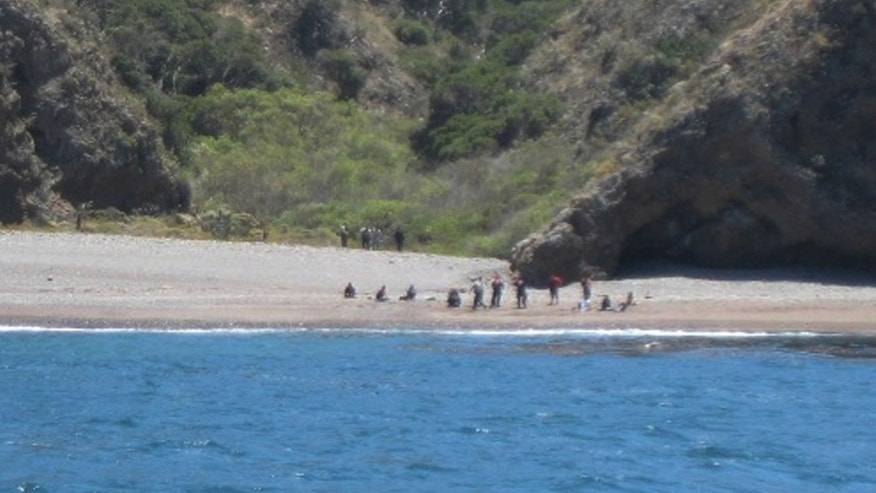 July 11: Coast Guard and National Park Service personnel with the apprehension of 15 suspected illegal migrants, near Santa Cruz Island, Calif.