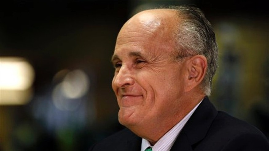 Former New York City Mayor Rudy Giuliani smiles during a visit to the Manchester Harley Davidson store in Manchester, N.H., July 14.