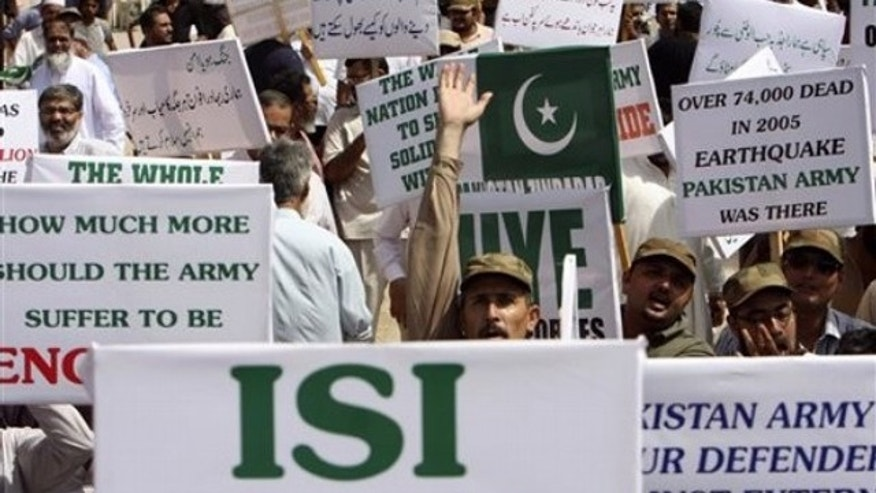 Members of a Pakistani civil society hold placards during a rally in support of Pakistan's army and the Inter-Services Intelligence agency, ISI, in Karachi, Pakistan May 14.