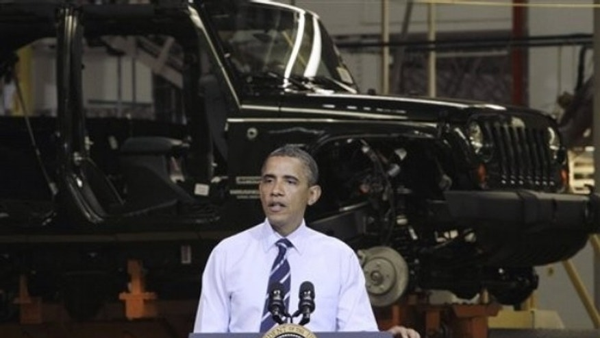 President Obama speaks at Chrysler Group's Toledo Assembly complex in front of a Jeep Wrangler, Friday, June 3, 2011, in Toledo, Ohio.