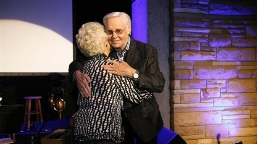 George Jones hugs Jean Shepard after inducting her into the Country Music Hall of Fame during the private Medallion Ceremony at The Country Music Hall of Fame and Museum in Nashville, Tenn. on Sunday, May 22, 2011.