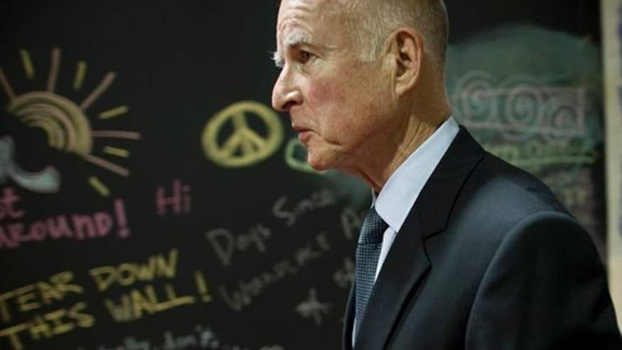 OAKLAND, CA - NOVEMBER 3:   California Governor-elect Jerry Brown walks away from the podium after a news conference at his campaign headquarters on November 3, 2010 in Oakland, California.