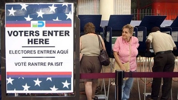 MIAMI - OCTOBER 21:  Hispanic voters go to the polls for early voting at the Miami-Dade Government Center on October 21, 2004 in Miami, Florida. Early voting began this week in Florida and is under heavy scrutiny after the debacle in the 2000 election.  (Photo by G. De Cardenas/Getty Images)