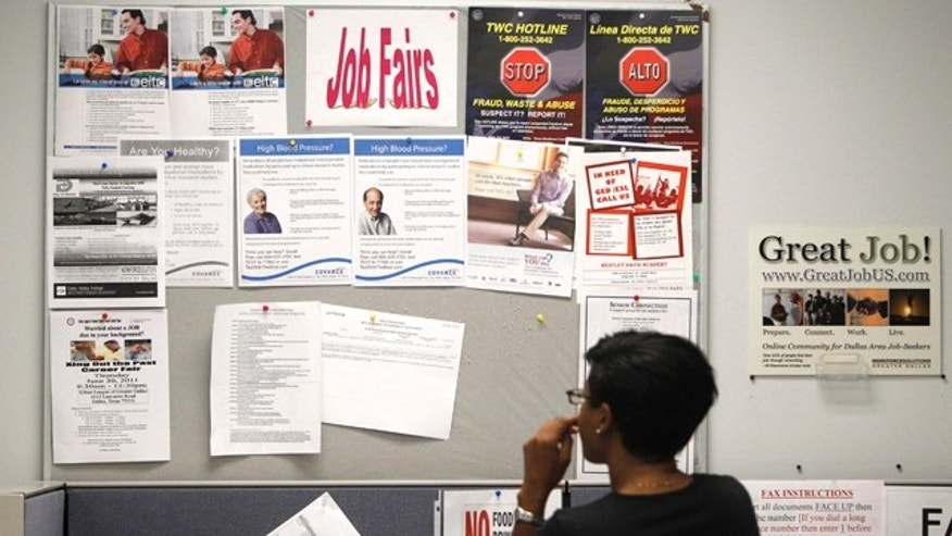 July 5: A job seeker looks at a bulletin at the Texas Workforce Commission's Workforce Solutions of Greater Dallas job resource center in Richardson, Texas.