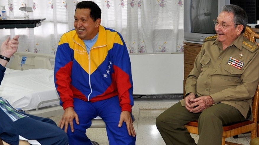 Cuban former President Fidel Castro, left, and brother, President Raul Castro, right, speak with Venezuelan President Hugo Chavez at a hospital as Chavez recuperates from surgery in Havana, Cuba.