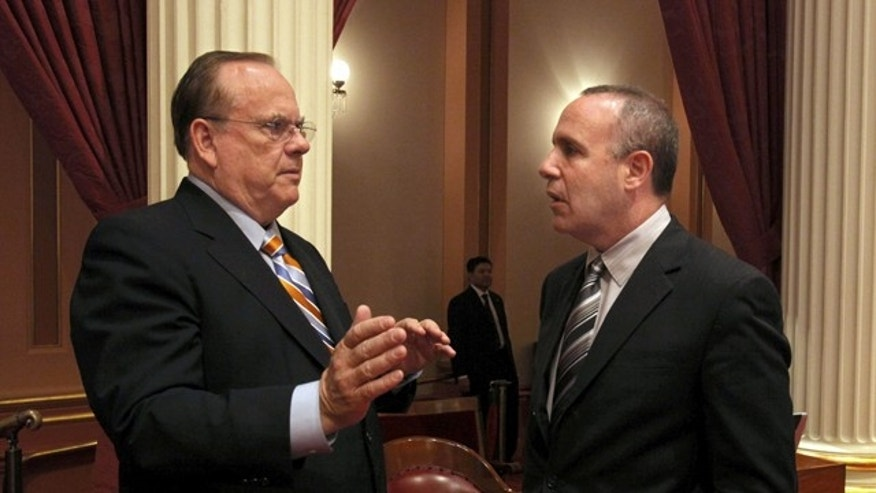 In this 2012 photo, state Treasurer Bill Lockyer, left, talks with Senate President Pro Tem Darrell Steinberg, D- After a speech before the Sacramento Press Club. State Treasurer Bill Lockyer says a failure to raise the federal debt ceiling could well throw credit markets into turmoil.