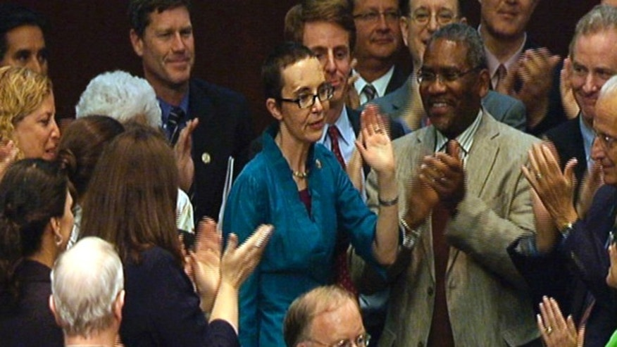 Aug. 1, 2011: In this image from House TV, Rep. Gabrielle Giffords, D-Ariz., appears on the floor of the House for a vote on the plan to raise the federal debt limit.
