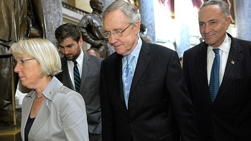 July 31: Senate Majority Leader Harry Reid of Nev., second from right, Sen. Charles Schumer, D-N.Y., right, Sen. Patty Murray, D-Wash., left, and Sen. Richard Durbin, D-Ill., walk through the Capitol after a meeting with House Democratic Leader Nancy Pelosi, D-Calif., on Capitol Hill in Washington.