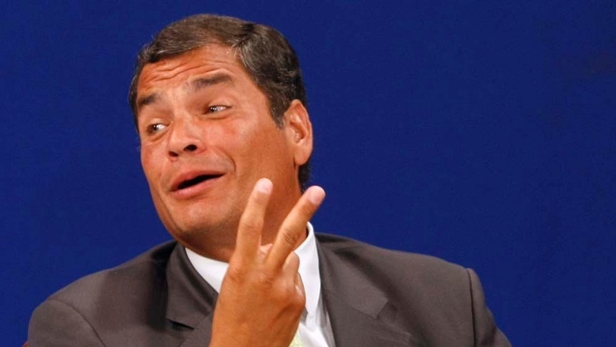 Ecuador's President Rafael Correa gestures after listening favorable reports about a referendum he proposed as he is interviewed during a TV broadcast at GamaTV station in Quito, Ecuador, Saturday, May 7, 2011. An exit poll indicates Ecuador's voters have roundly approved 10 ballot questions proposed by Correa that critics say could inhibit press freedom and lessen the judiciary's independence. (AP Photo/Dolores Ochoa)