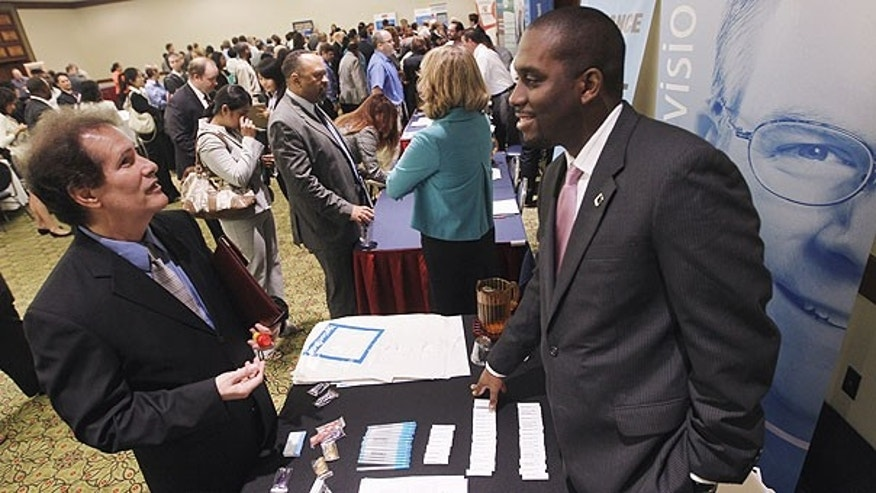 Aug. 4: Recruiter Jason Bryant, right, speaks with job seeker Brian Shumate at the Career Job Fair in Arlington, Va.