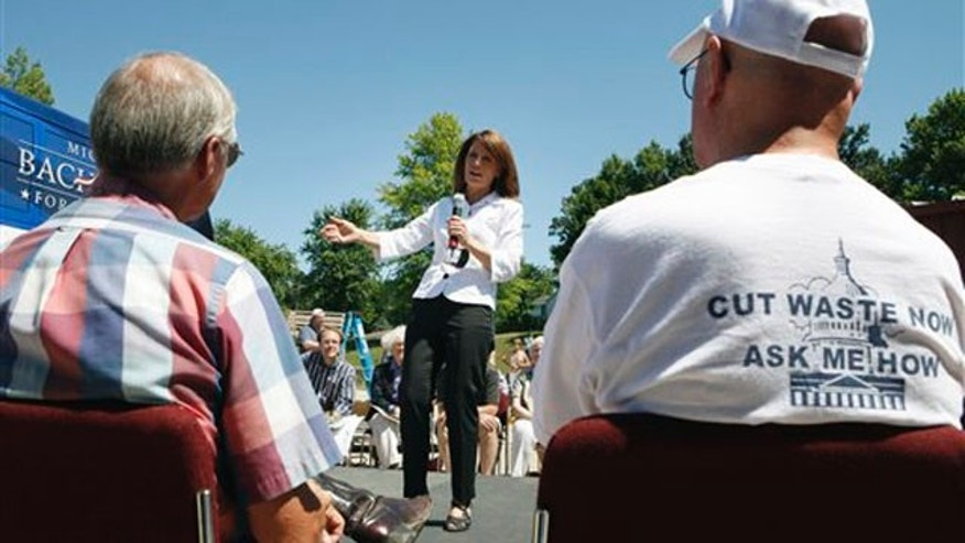 Rep. Michele Bachmann speaks to local residents during a meeting at the local community center Aug. 8 in Atlantic, Iowa.