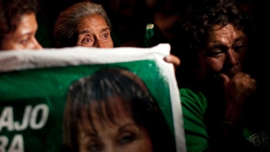 Supporters of Guatemala's former first lady Sandra Torres react after hearing about the rejection of their presidential candidate by the Contitutional Court in Guatemala City, Monday Aug. 8, 2011. Torres, who wanted to run for president, recently divorced her husband President Alvaro Colom because Guatemalan law forbids close relatives of the president from running for office. A court's decision on July 12 upheld a lower-court ruling that the presidential couple's divorce was a ruse aimed at getting around the law. Torres' last legal recourse is to appeal to the country's highest court to allow her on the Sept. 12 ballot. Guatemala's Constitutional Court is the final court of appeal. (AP Photo/Rodrigo Abd)