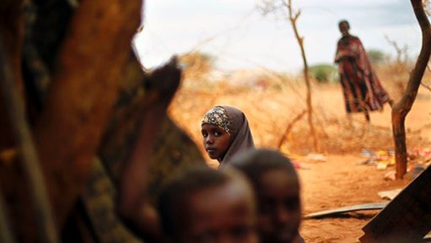 Tuesday: A Somali refugee sits at an outdoor madrasa at the Ifo camp outside Dadaab, Eastern Kenya.