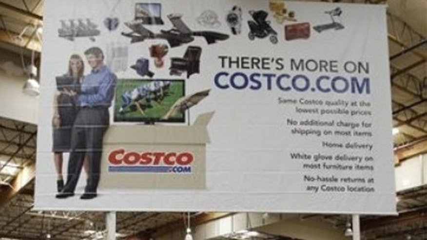 In this June 17, 2011, photo, a hot tub is on display in front of advertising for online service Costco.com at Costco in Mountain View, Calif. Costco has spent $2.3 million on an initiative that would privatize liquor sales in the state.
