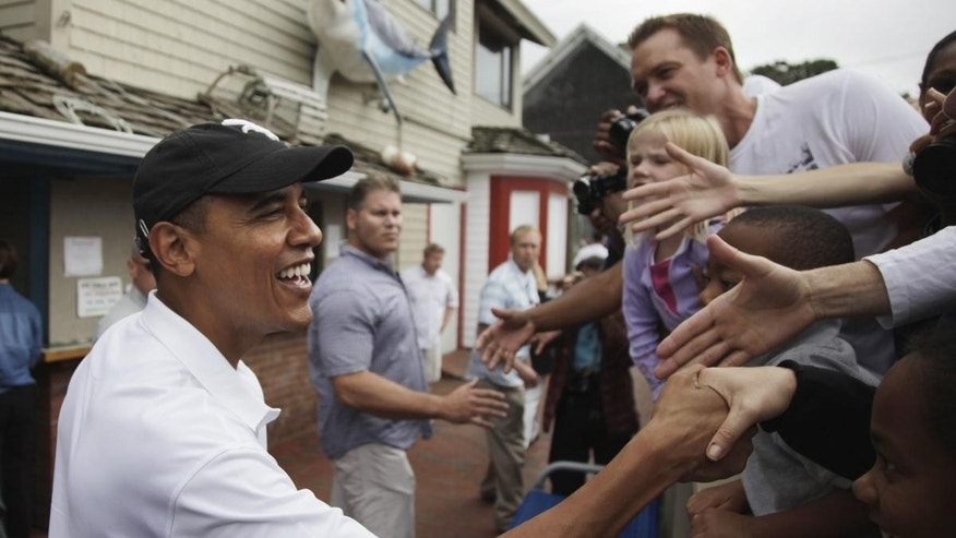 (AP File Photo Aug. 25, 2010) President Barack Obama greets people gathered outside Nancy's Restaurant in Oak Bluffs on Martha's Vineyard, Mass. He will vacation with his family in Martha's Vineyard at the end of this month as he's done in years past, the White House said Wednesday.