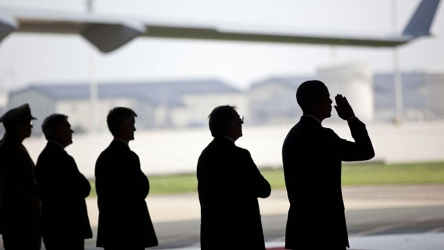 The White House released this picture of President Obama at Dover Air Force Base in Delaware on Aug. 9, 2011, receiving the planes carrying the bodies of the 30 U.S. service members killed when their helicopter was downed by an RPG in Afghanistan.