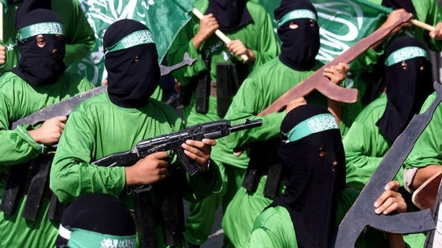 In this Oct. 24, 2003, file photo, Palestinian masked Hamas terrorists march during a protest rally at Jabaliya refugee camp in the Gaza Strip.