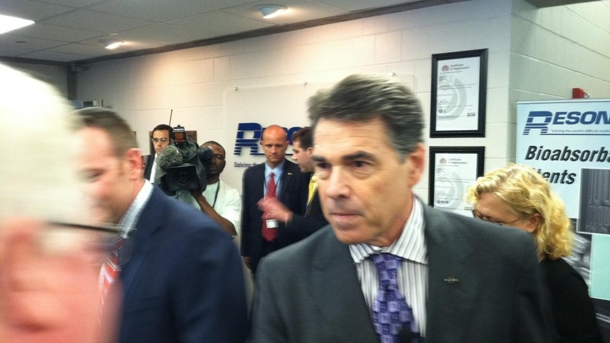 Rick Perry greets participants at an economic roundtable in Nashua, NH on Wednesday