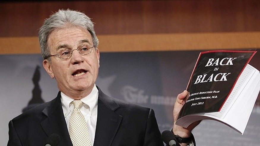 "July 18: Sen. Tom Coburn, R-Okla. reveals his ""Back in Black"" plan to reduce the federal deficit during a news conference on Capitol Hill in Washington."