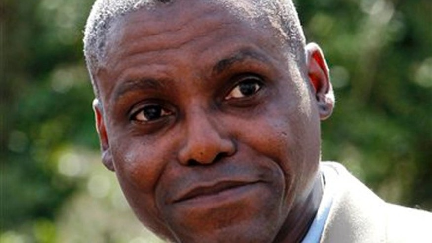 In this April 11, 2011 file photograph, former Olympic gold medalist Carl Lewis announces in Mount Holly, N.J., his candidacy for the New Jersey state Senate seat to represent his hometown of Willlingboro.