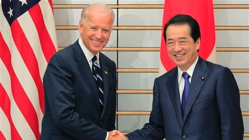 August 24: Vice President Joe Biden shakes hands with Japanese Prime Minister Naoto Kan in Tokyo, Japan.