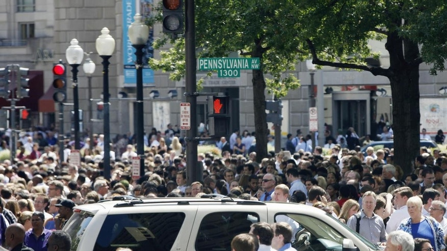 People crowd Pennsylvania Avenue in Washington, Tuesday, Aug. 23, 2011, as buildings were evacuated following an earthquake. (AP Photo/Charles Dharapak)