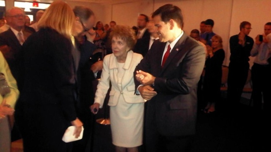 Tuesday: Florida Sen. Marco Rubio escorts former first lady Nancy Reagan to her seat after helping to prevent her from stumbling as they entered the room for a speech Rubio was delivering at the Reagan Presidential Library in Simi Valley, Calif.