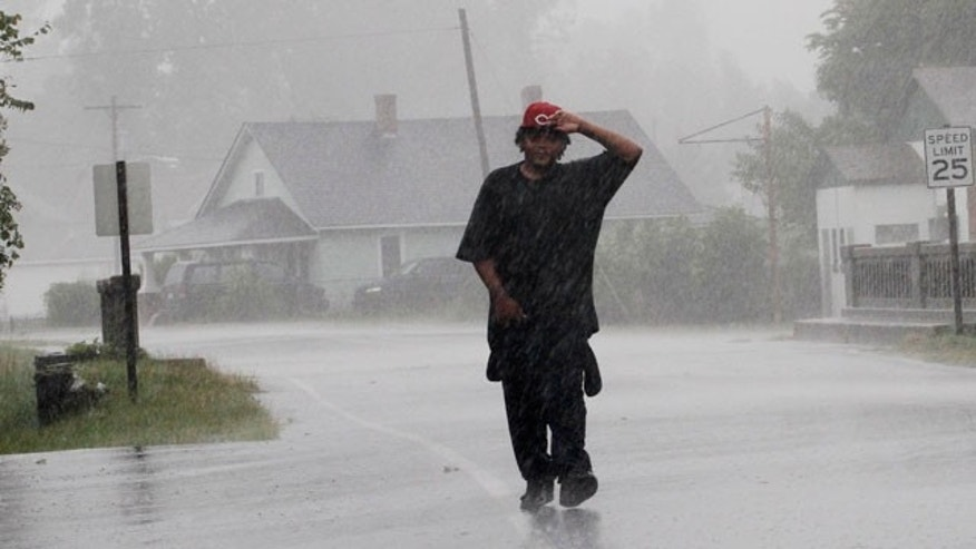 Aug. 27, 2011: Antoine White walks in the effects of Hurricane Irene in Elizabeth City, N.C.,  as the storm moves up the North Carolina coast.
