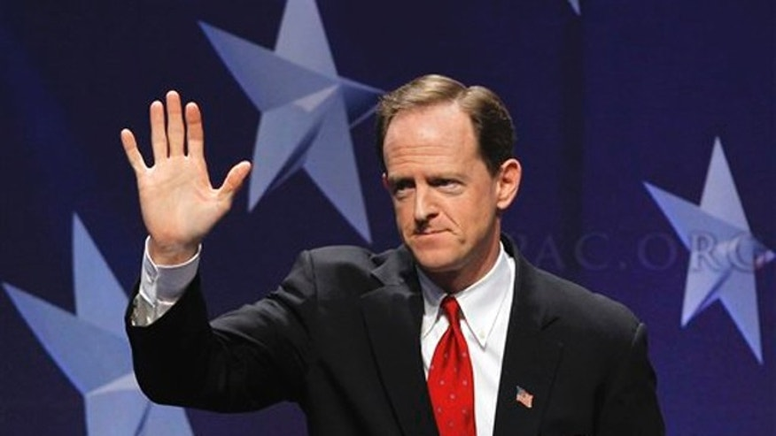 February 10, 2011: Sen. Pat Toomey, R-Pa. waves after addressing the Conservative Political Action Conference (CPAC) in Washington. Toomey is one of a dozen lawmakers on the debt supercommittee, given the task of producing a deficit-cutting plan of $1.5 trillion in savings over a decade.