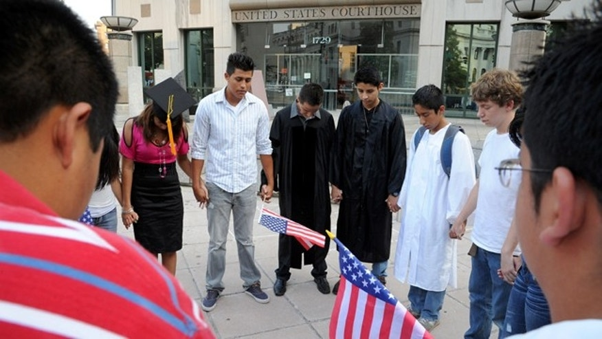 Aug. 24: Hispanic protestors pray outside the federal courthouse during an all-day hearing over efforts to persuade a federal judge to block Alabama's immigration law in Birmingham, Ala. On Aug. 29 A federal judge temporarily blocked enforcement of Alabama's new law cracking down on illegal immigration.