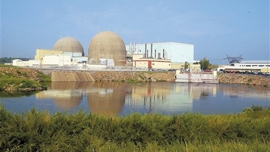 In this Feb. 10, 2005 file photo, The containment domes enclosing the North Anna Power Station's two nuclear reactors rise over a discharge canal at the Louisa plant in Spotsylvainia county Va.