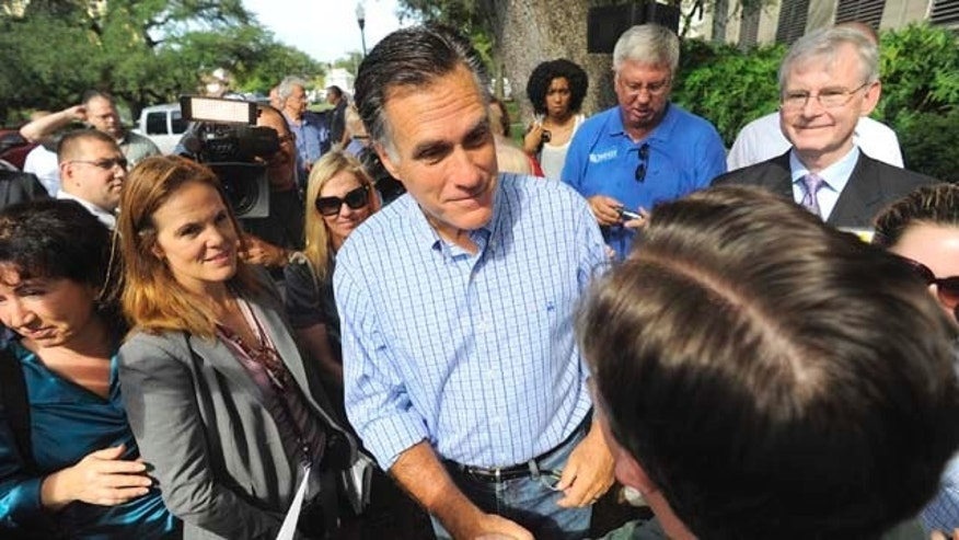 Republican presidential candidate, former Massachusetts Gov. Mitt Romney, center, meets with supporters during the grand opening of his Florida campaign headquarters in Tampa, Fla., Friday, Sept. 2, 2011. (AP Photo/Brian Blanco)