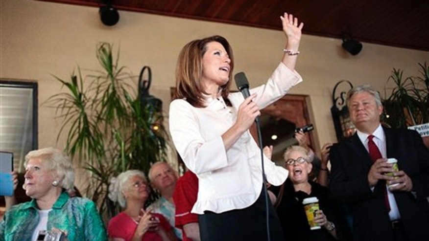Rep. Michele Bachmann talks to a group of supporters on the porch of a bakery in Naples, Fla., on Aug. 29 during a campaign stop.