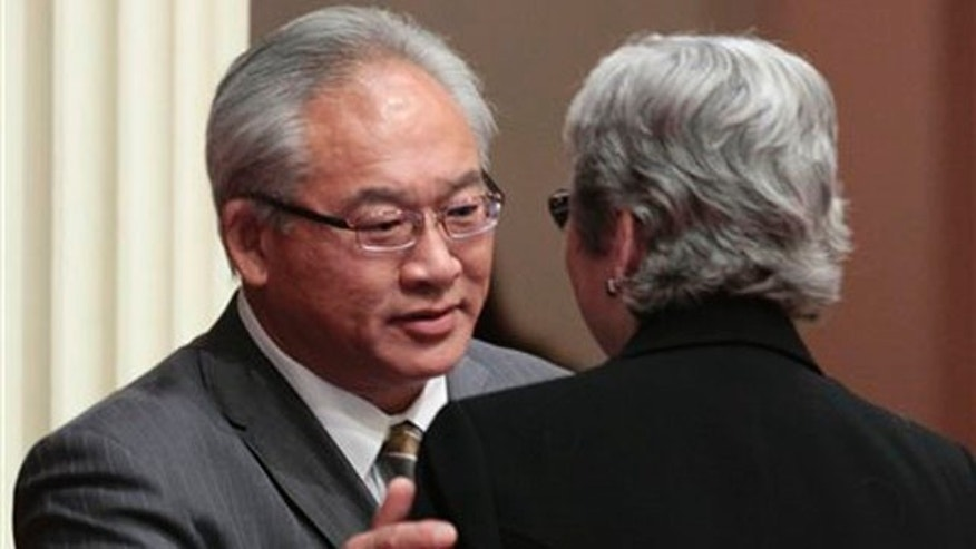 Assemblyman Paul Fong, D-Cupertino, thanks  Sen. Christine Kehoe, D-San Diego, for help after his measure banning the sale, trade or possession of shark fins was approved by the Senate in Sacramento, Calif., Tuesday, Sept. 6, 2011.