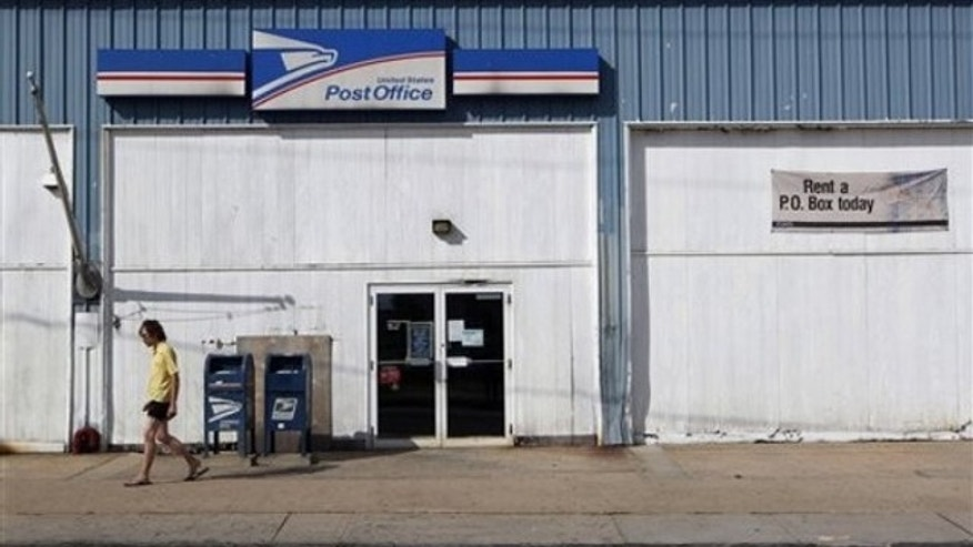 A man walks away from a post office July 27 in New Brunswick, N.J.