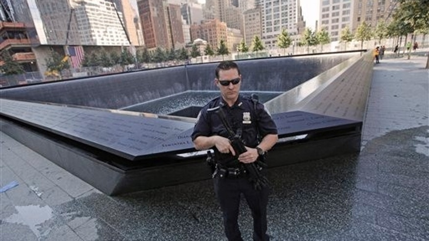 Sept. 9: A heavily armed Port Authority police officer stand guard next to the North Pool at the World Trade Center memorial site Friday, in New York. Just days before the 10th anniversary of the Sept. 11 attacks, U.S. counterterrorism officials are chasing a credible but unconfirmed al-Qaida threat to use a car bomb on bridges or tunnels in New York City or Washington.