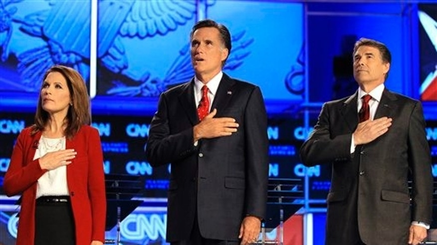 Sept 12: Republican presidential candidates, from left, Rep. Michele Bachmann, R-Minn, former Massachusetts Gov. Mitt Romney and Texas Gov. Rick Perry before a Republican presidential debate in Tampa, Fla.
