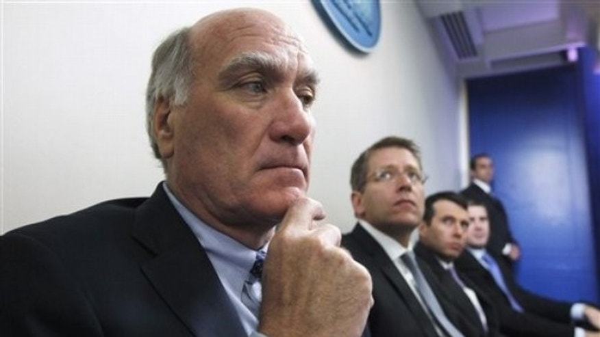 FILE: In this July, 11, 2011, photo, White House Chief of Staff William Daley and others listen as President Obama speaks in the White House press briefing room.