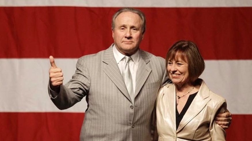 FILE: In this Oct. 29, 2010, photo, Michael Reagan, son of the late U.S. president Ronald Reagan, introduces Nevada U.S. Senate candidate Sharron Angle during a Get Out the Vote rally in Las Vegas.
