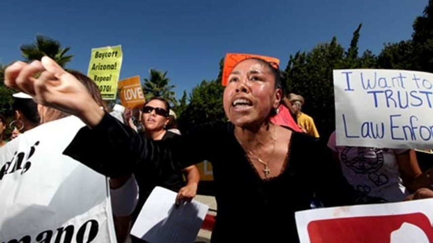 SAN DIEGO, CA - Aug 10: Olga Torres chants along with other people during a protest against Maricopa County Sheriff Joe Arpaio during his visit to the Rancho Bernardo Inn on Tueday, August 10, 2010 in Rancho Bernardo, California.  Arpaio, who is Sheriff of Maricopa County in Arizona,  gained National attention by for using deputies to conduct raids to apprehend illegal immigrants and build large prison tents to house inmates.(Photo by Sandy Huffaker/Getty Images)